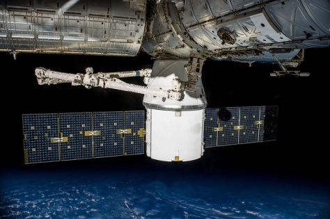 Meet the Dragon, a Space X free flying private cargo space craft. Here is docks with the ISS (Image: Space X)